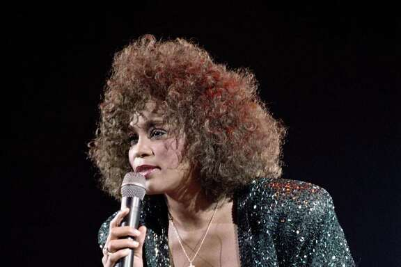 (FILES) A file picture taken on May 18, 1988 in Paris shows US singer Whitney Houston performing at the POPB (Bercy hall). Grammy-winning pop legend and actress Whitney Houston, 48, was found dead on February 11, 2012 in a Beverly Hills hotel, police said. AFP PHOTO BERTRAND GUAY (Photo credit should read BERTRAND GUAY/AFP/Getty Images)