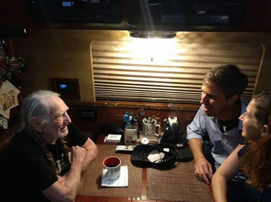 U.S. Senate candidate Beto O'Rourke was invited on stage by country music legend Willie Nelson to play guitar in Austin during Nelson's annual 4th of July Picnic. (Photo via Beto O'Rourke's Instagram) Photo: Jeremy Wallace
