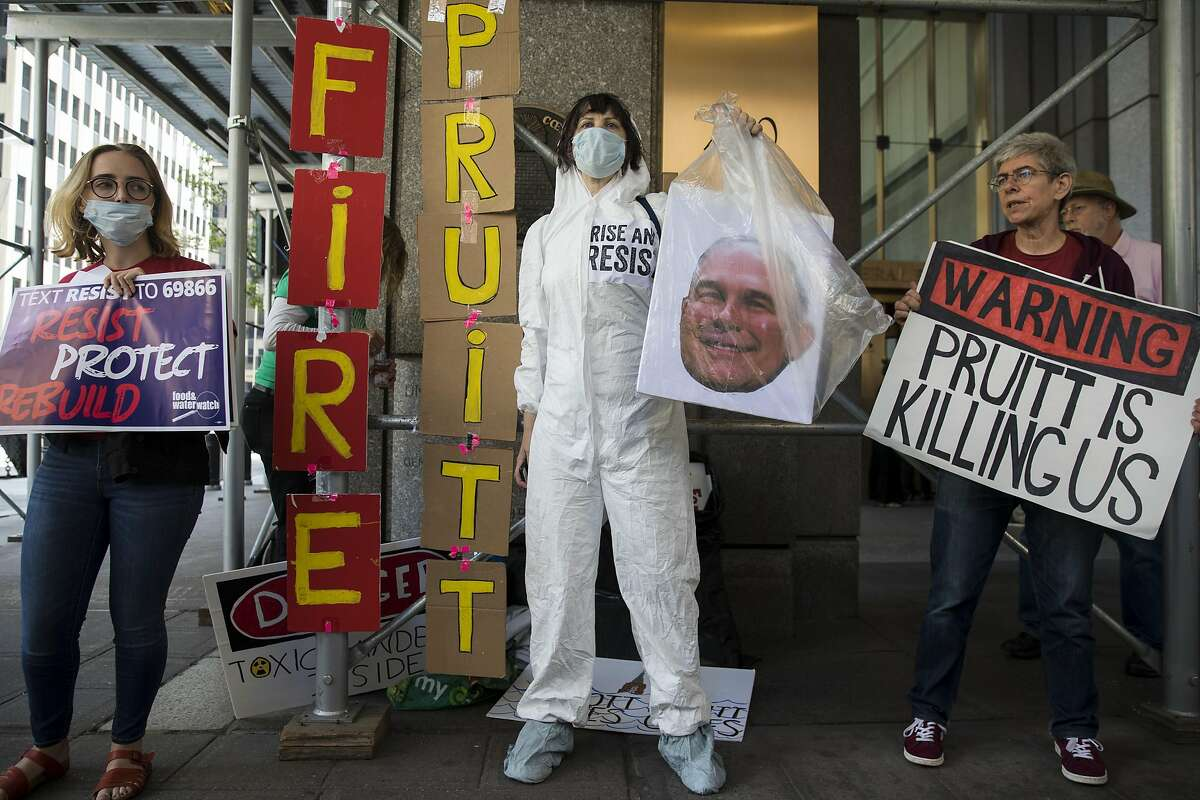 NEW YORK, NY - JUNE 6: Protestors rally against Environmental Protection Agency (EPA) Administrator Scott Pruitt outside the federal office building that houses the New York City office of the Environmental Protection Agency (EPA), June 6, 2018 in New York City. Pruitt is under fire again this week after emails showed he asked an EPA staff member to contact Chick-fil-A for potential business opportunities for his wife. Federal ethics rules prohibit government employees from using their positions for private gain and prohibit supervisors from directing subordinates to carry out personal errands. Earlier in the week it was also disclosed that Pruitt asked an aide to inquire with the Trump International Hotel about purchasing a used mattress. (Photo by Drew Angerer/Getty Images)