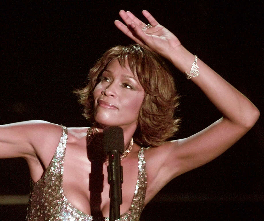 Entertainer Whitney Houston strikes a pose during her performance at the Shrine Auditorium in Los Angeles, Monday, April 10, 2000,  during taping of the '25 Years of #1 Hits: Arista Records' Anniversary Celebration.'  The show is scheduled to air on NBC, Monday, May 15.  Houston took the stage to a standing ovation in a heavily scrutinized six-song performance during the taping Monday night. (AP Photo/Mark J.Terrill) Photo: MARK J. TERRILL / AP