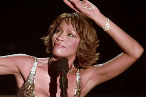 Entertainer Whitney Houston strikes a pose during her performance at the Shrine Auditorium in Los Angeles, Monday, April 10, 2000,  during taping of the '25 Years of #1 Hits: Arista Records' Anniversary Celebration.'  The show is scheduled to air on NBC, Monday, May 15.  Houston took the stage to a standing ovation in a heavily scrutinized six-song performance during the taping Monday night. (AP Photo/Mark J.Terrill)