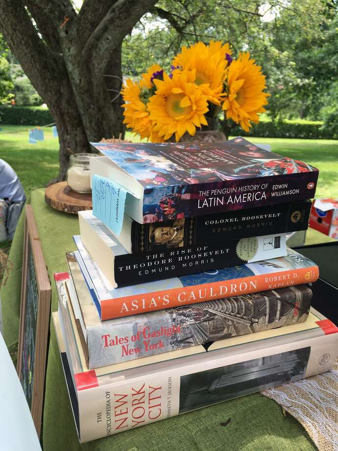 Over 100,000 books, CDs and DVDs will be for sale at Pequot Library's 58th annual summer book sale this month. Photo: Contributed Photo