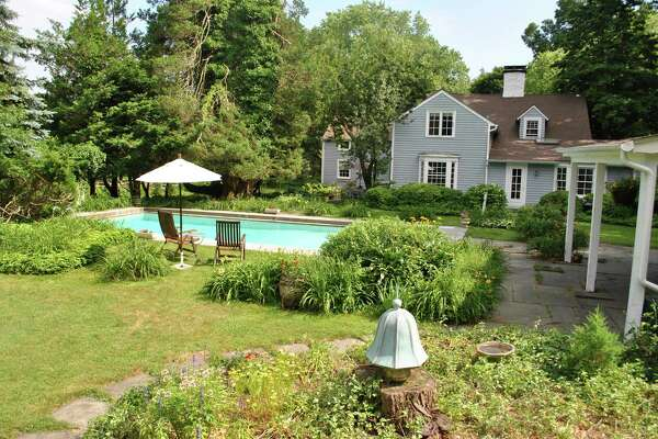 The pool and backyard lawn of the Selleck house at 21 Old Farm Road, which predates the Revolutionary War.