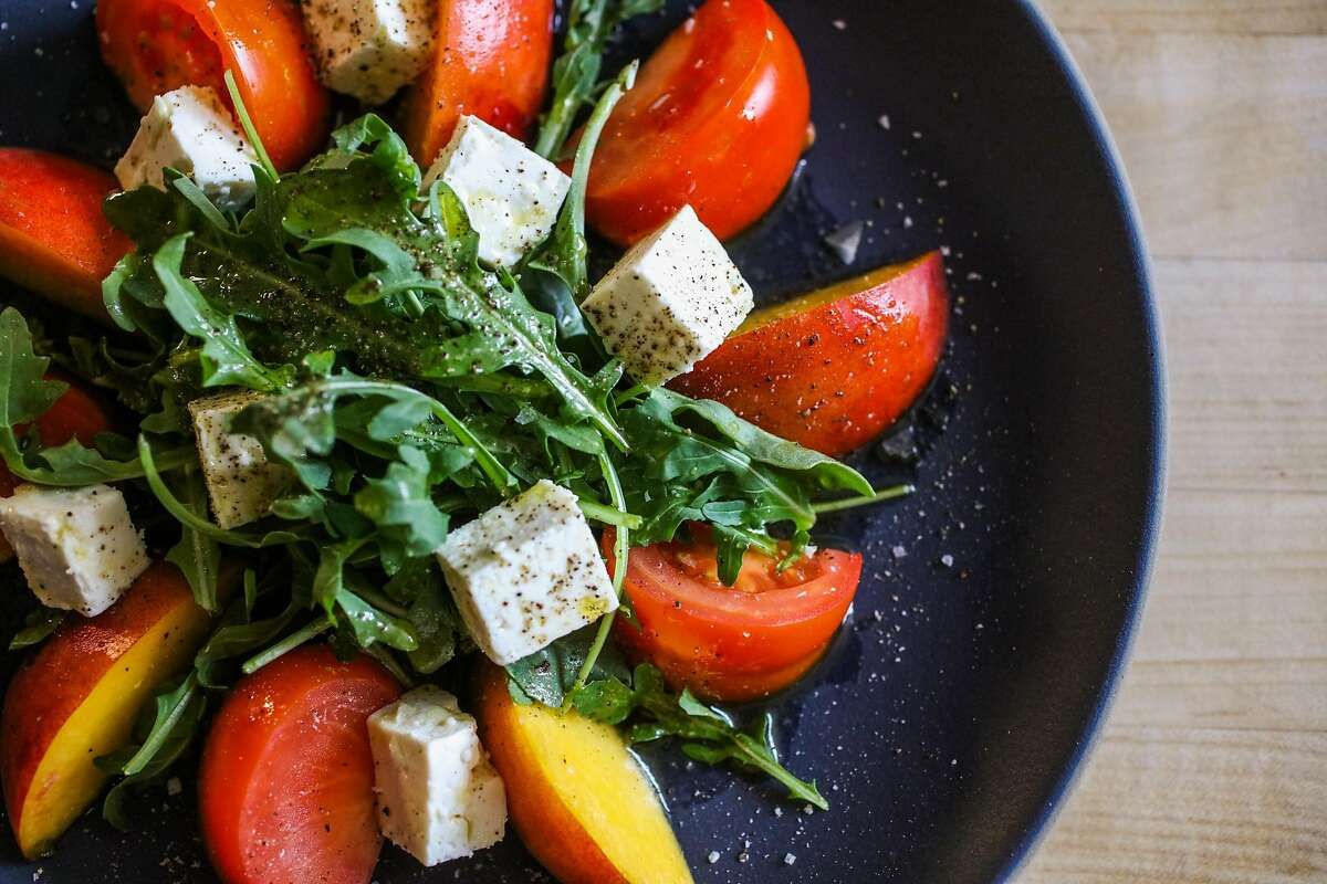 Heirloom tomato salad with peaches is seen in the Chronicle test kitchen in San Francisco, California, on Tuesday, July 3, 2018.