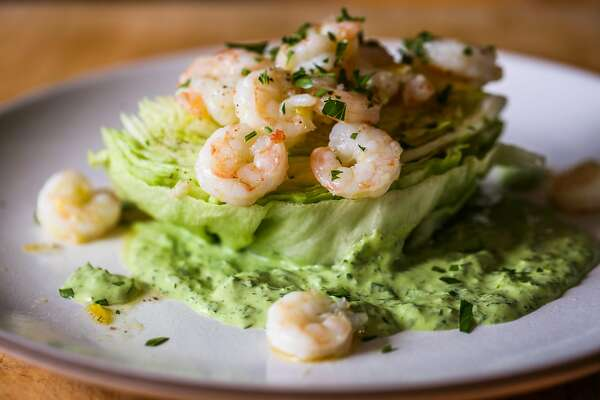 The baby iceberg wedge salad with chilled shrimp, mint and green goddess dressing is seen in the Chronicle test kitchen in San Francisco, California, on Tuesday, July 3, 2018.