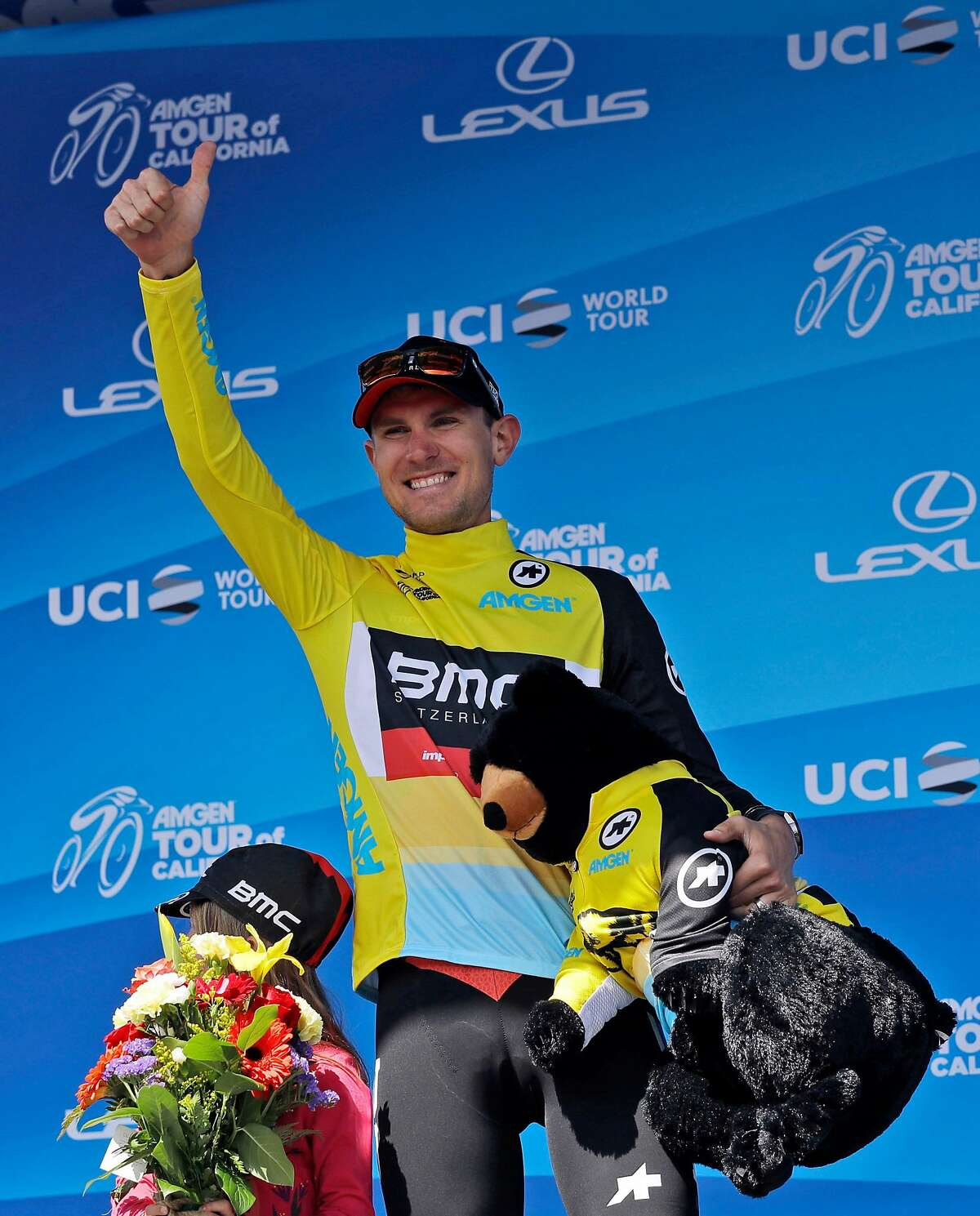 Tejay van Garderen celebrates on the podium after winning Stage 4, the individual time trial, of the Tour of California cycling race Wednesday, May 16, 2018, in Morgan Hill, Calif. (AP Photo/Marcio Jose Sanchez)