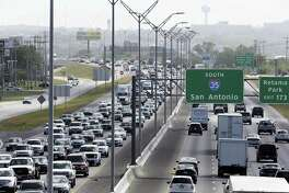Traffic proceeds along I35 on the North Side during rush hour on Friday afternoon, June 29, 2018.