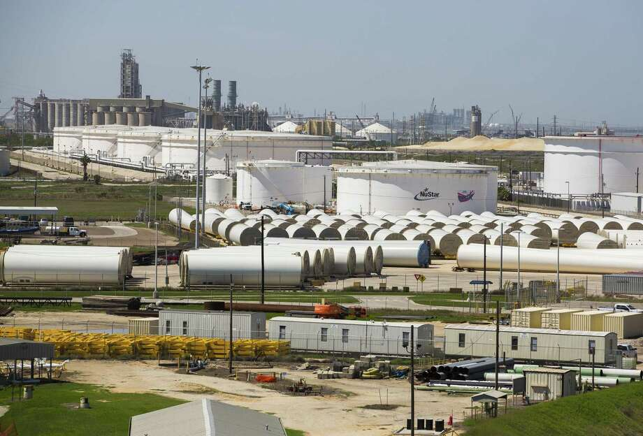 Oil storage tanks and wind turbine components line a portion of the main channel of the Port of Corpus Christi near the Harbor Bridge, Wednesday, March 7, 2018, in Corpus Christi. ( Mark Mulligan / Houston Chronicle ) Photo: Mark Mulligan, Houston Chronicle / Houston Chronicle / © 2018 Houston Chronicle