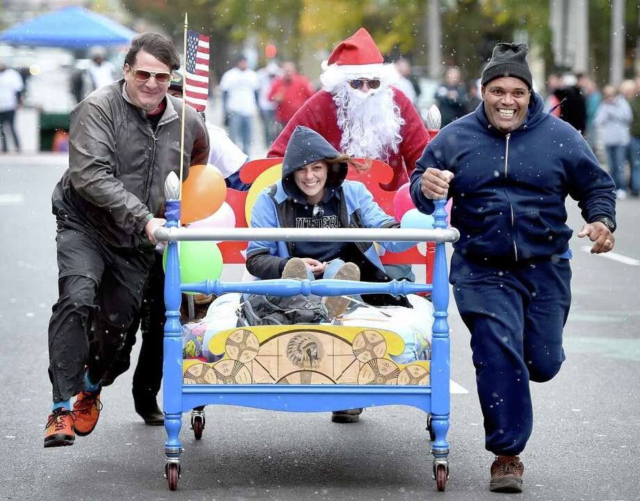 (Arnold Gold-New Haven Register)  The Citizens Television team competes in the resurrected New Haven Bed Race on Church St. in New Haven on 10/18/2015.