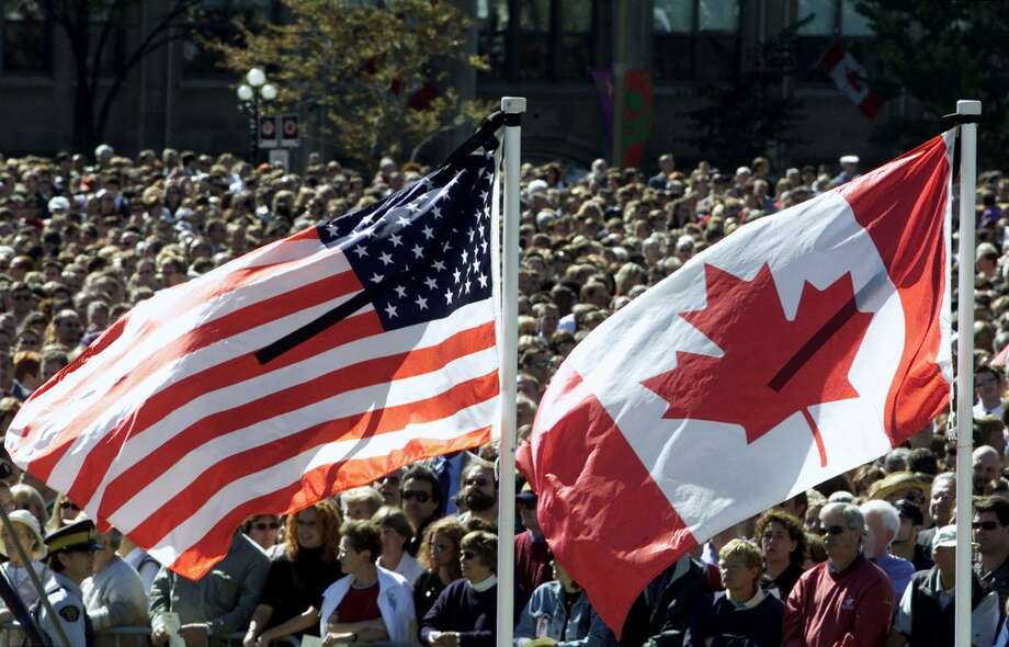 Thousands of Canadians gathered in Ottawa on Sept. 14, 2001 for a ceremony honoring U.S. victims of the 9/11 terrorist attacks. Photo: TOM HANSON, STF / AP / CP