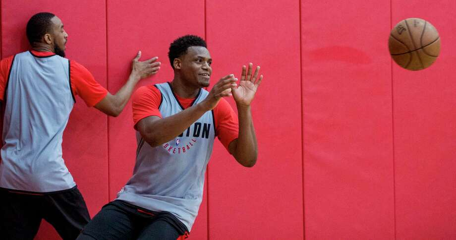 PHOTOS: Rockets vs. Wizards  Houston Rockets forward Danuel House takes a pass during practice for the Rockets NBA rookie summer league at Toyota Center on Thursday, July 5, 2018, in Houston.  >>>See photos from the Rockets' game against the Wizards on Monday ...  Photo: Brett Coomer, Houston Chronicle / © 2018 Houston Chronicle
