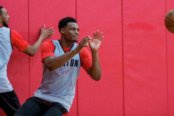 Houston Rockets forward Danuel House takes a pass during practice for the Rockets NBA rookie summer league at Toyota Center on Thursday, July 5, 2018, in Houston.