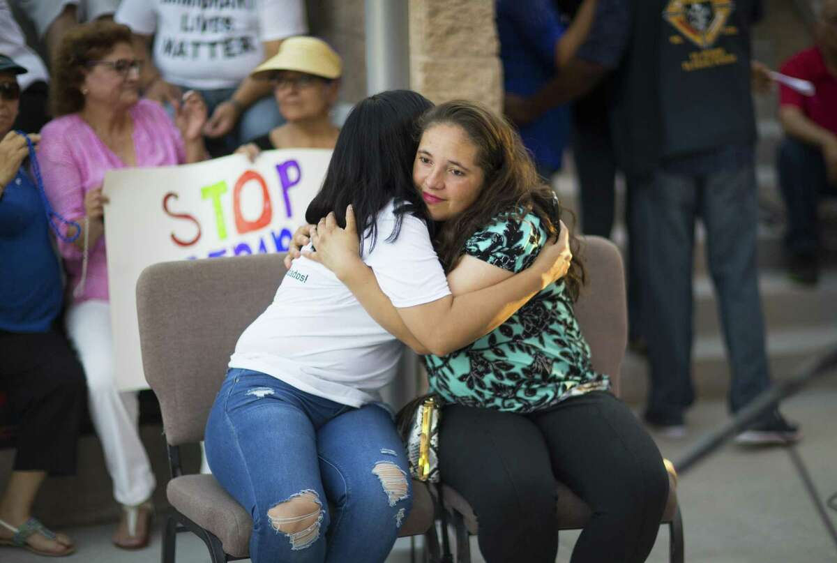 Mariana Ibarra and Jocelyn Alves embrace moments before they talk about their experience of being separated from their sons by CBP at the border, at Saint Mark Catholic Church during a solidarity with migrants vigil, Thursday, June 21, 2018, in El Paso. Photo by Ivan Pierre Aguirre