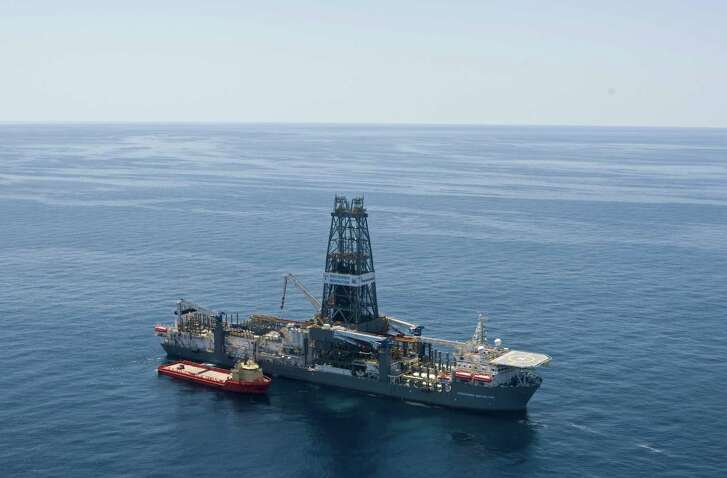 A supply vessel is shown next to the Discoverer Inspiration on Tuesday, March 30, 2010.  The derrick is 226 feet high.  Chevron is drilling an exploration well into Moccasin Prospect on Transocean's Discoverer Inspiration, an ultra-deepwater drillship, located about 240 nautical miles from Leesville, Louisiana in the U.S. Gulf of Mexico. The vessel has the capability to drill wells in 12,000 feet of water to a total depth of 40,000 feet.  ( Melissa Phillip / Chronicle )