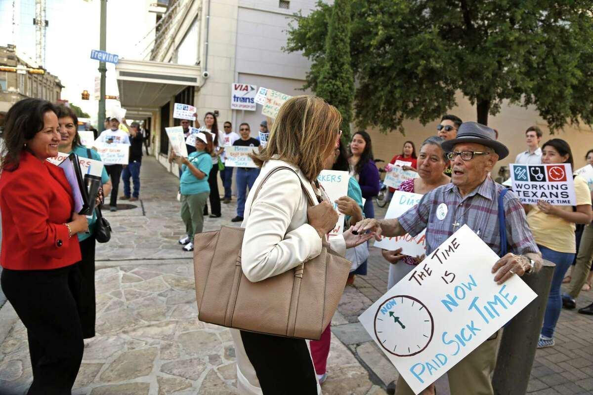 Councilwoman Shirley Gonzales greets Jesse R. Vidales who was with a small group of protesters calling for mandatory paid sick leave for workers in San Antonio last month.