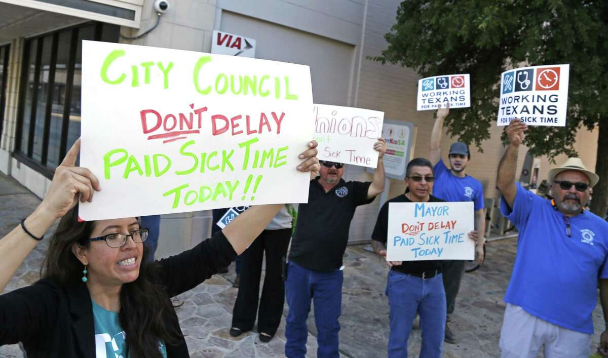 Jolene Garcia, community organizer for Working Texans for Paid sick leave, leads a chant by a small group of protestors calling for mandatory paid sick leave for workers in San Antonio last month.