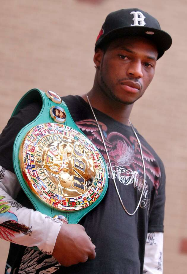 "NEW HAVEN-THE CHAMP-PHOTO/JEFF HOLT-JH00184D 2/13/07-""Bad"" Chad Dawson, the WBC-Light-Heavy Weight Champion of the World, with his championship belt. Dawson was at the New Haven YMCA to meet and talk with after-school and pre-school kids. (Photo/Jeff Holt)"