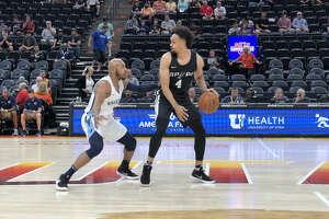 Derrick White finished with a team-high 26 points to help the Spurs beat the Memphis Grizzlies in the Utah Summer League on Thursday. Photo by Jabari Young