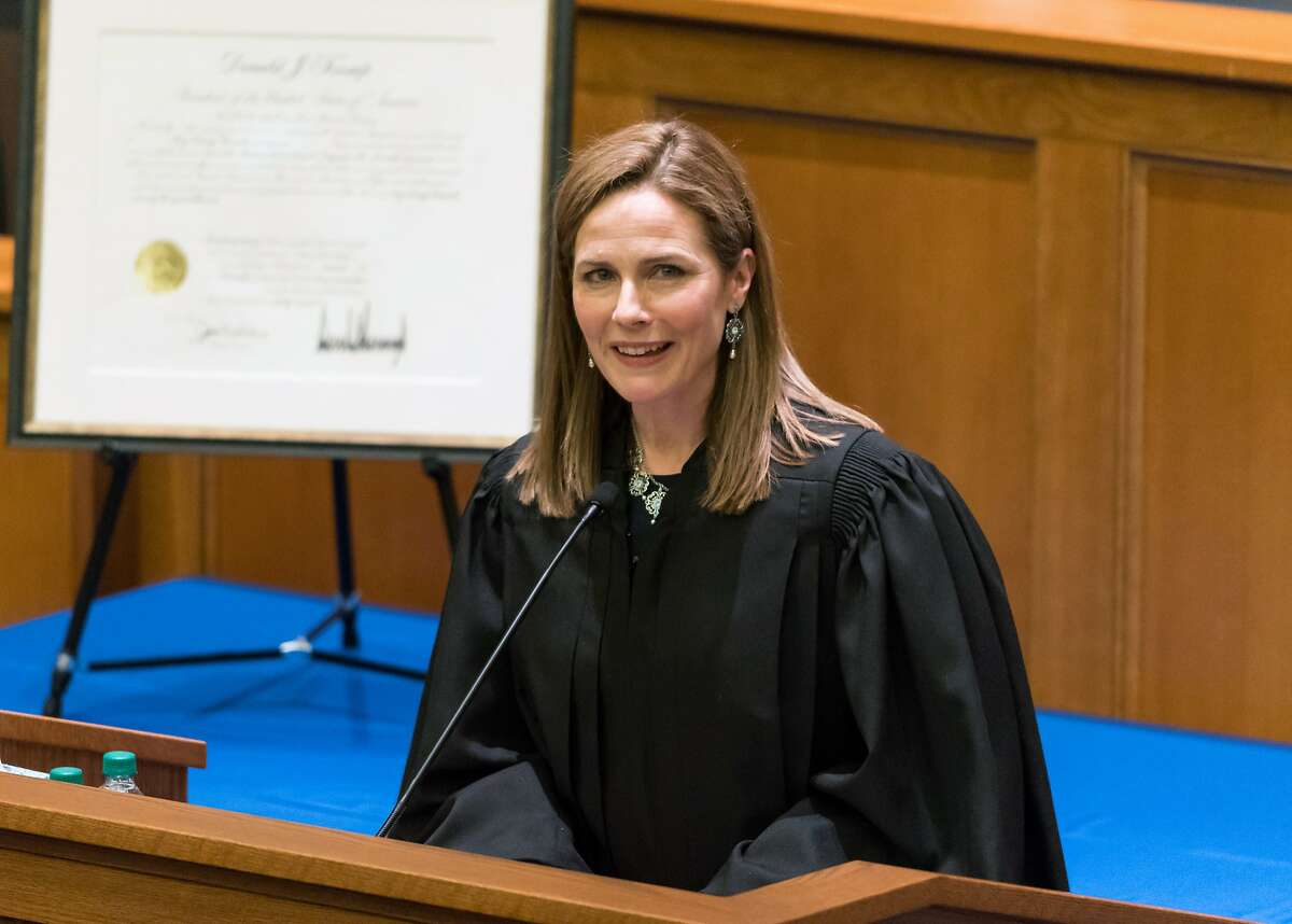 FILE - In a photo provided by Julian Velasco, Amy Coney Barrett speaks during a ceremony for her investiture as a judge for the U.S. Court of Appeals for the Seventh Circuit in February 2018 at Notre Dame Law School in South Bend, Ind.