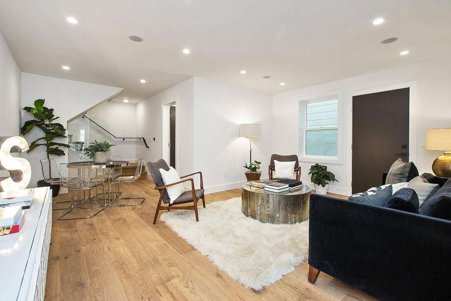 A family room resides on the lower level. Photo: Open Homes Photography