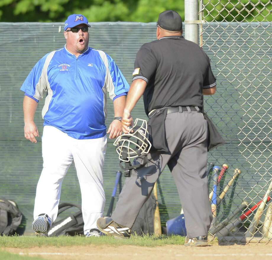 In this photo from last year's state tournament, Middletown coach Tim D'Aquila argues with umpire Pete Stokes during a game against Greenwich. Photo: Matthew Brown / Hearst Connecticut Media File Photo / Stamford Advocate