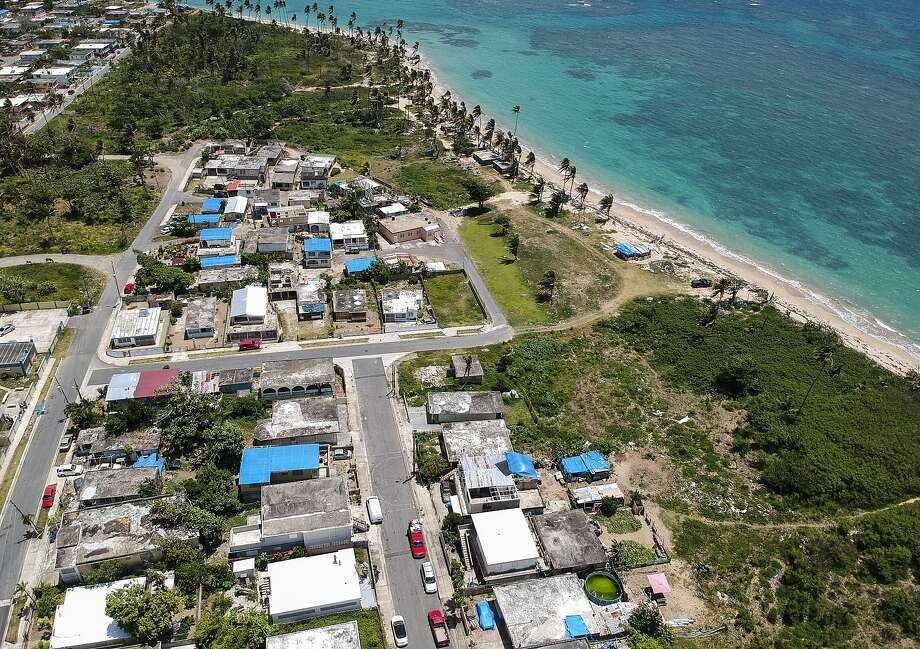 In this June 18, 2018 photo shows an aerial photo of the Viequez neighborhood, east of San Juan, Puerto Rico. Thousands of people across Puerto Rico were still living in damaged homes, protected by blue plastic tarps, nine months since Hurricane Maria devastated the island. Photo: Dennis M. Rivera, Associated Press