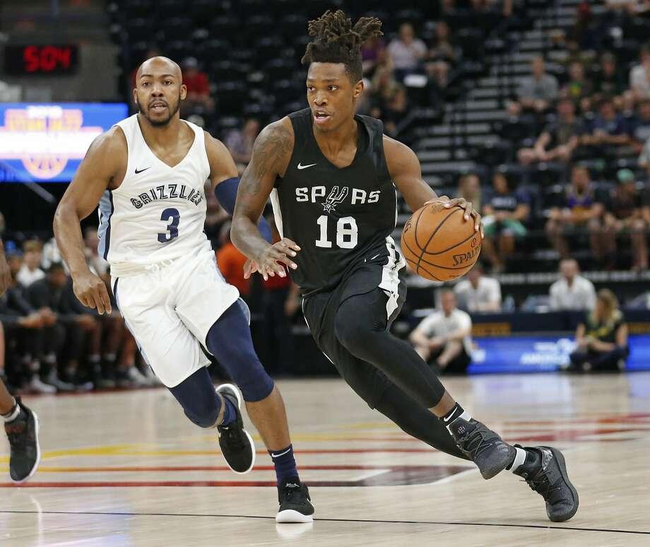 San Antonio Spurs guard Lonnie Walker IV (18) drives as Memphis Grizzlies guard Jevon Carter (3) trails during the first half of an NBA summer league basketball game Thursday, July 5, 2018, in Salt Lake City. (AP Photo/Rick Bowmer) Photo: Rick Bowmer, Associated Press