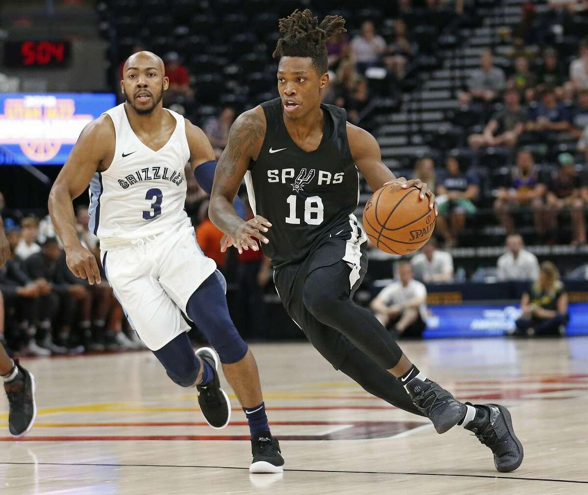 San Antonio Spurs guard Lonnie Walker IV (18) drives as Memphis Grizzlies guard Jevon Carter (3) trails during the first half of an NBA summer league basketball game Thursday, July 5, 2018, in Salt Lake City. (AP Photo/Rick Bowmer)