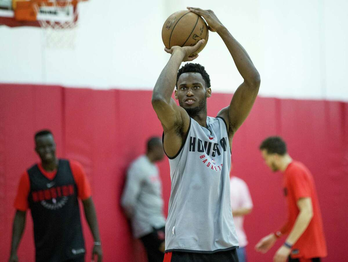 Roger Moute a Bidias takes his best shot in the Rockets' rookie summer league.