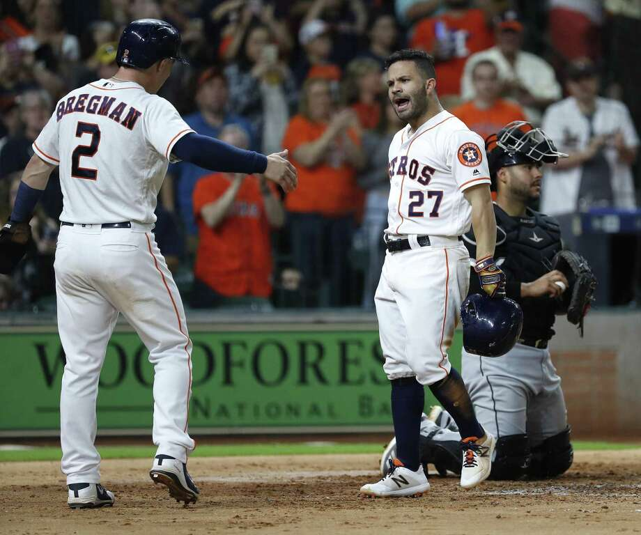 PHOTOS: Astros vs. White Sox Jose Altuve, right, celebrates with Alex Bregman after Altuve's two-run home run off Carlos Rodón of the White Sox during the fifth inning Thursday night at Minute Maid Park. Browse through the photos to see action from the Astros game against Chicago on Thursday. Photo: Karen Warren, Staff / Houston Chronicle / © 2018 Houston Chronicle