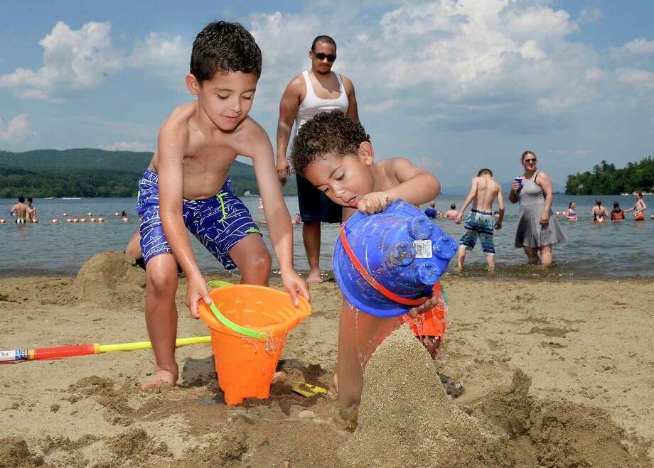 Six-year-old Calvin Herard, left, of Middletown helps his brother Kennedy, 3, build a sand castle during a visit to Million Dollar Beach Thursday July 5, 2018 in Lake George, NY.  (John Carl D'Annibale/Times Union) Photo: John Carl D'Annibale