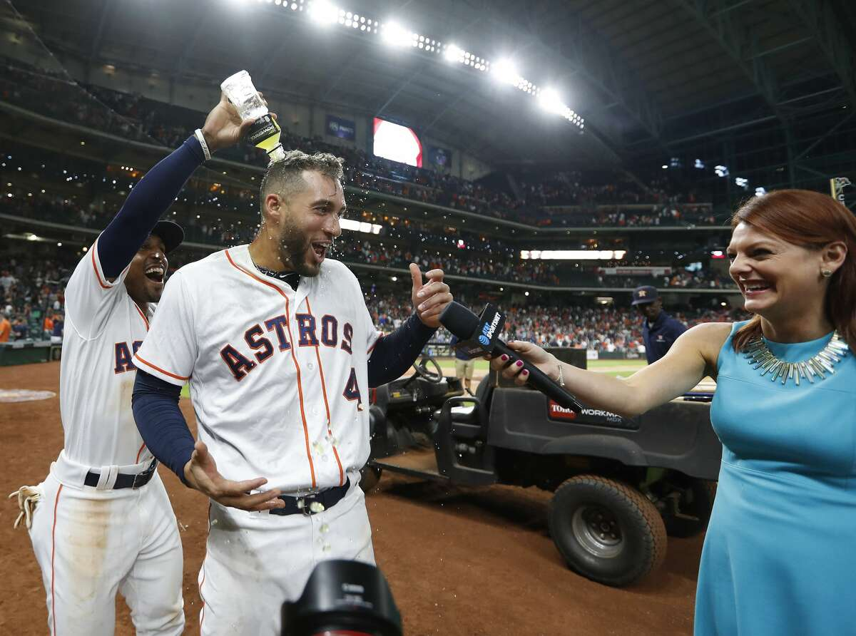 Houston Astros George Springer (4) is doused with Powerade by Tony Kemp (18) as he was interviewed by Julia Morales after his RBI single tied the game of an MLB game at Minute Maid Park, Thursday, July 5, 2018, in Houston. ( Karen Warren / Houston Chronicle )
