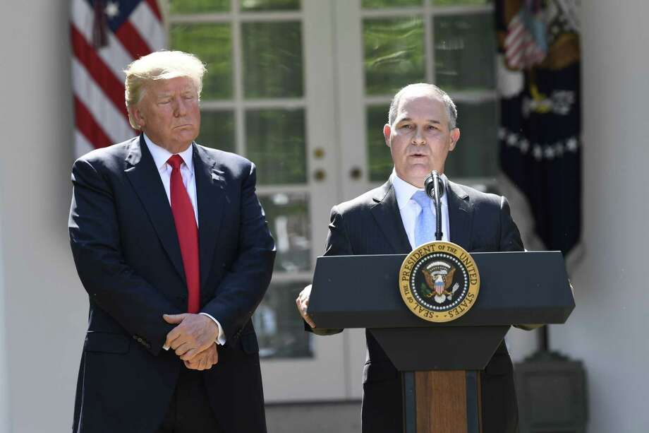 (FILES) In this file photo taken on June 1, 2017, the head of the Environmental Protection Agency Scott Pruitt, speaks after US President Donald Trump announced his decision to withdraw the US from the Paris Climate Accords in the Rose Garden of the White House in Washington, DC. President Donald Trump announced on July 5, 2018,the departure of scandal-hit environment chief Scott Pruitt amid ethics scandals.  / AFP PHOTO / SAUL LOEBSAUL LOEB/AFP/Getty Images Photo: SAUL LOEB