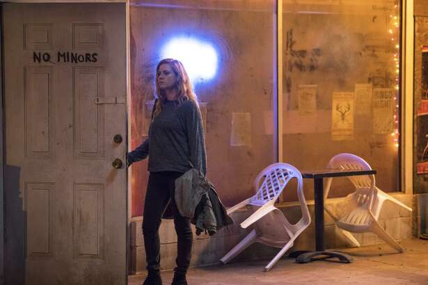"Amy Adams stars as a weary reporter haunted by her past who returns to her small hometown to cover the mysterious murder of two children in the HBO series ""Sharp Objects."""