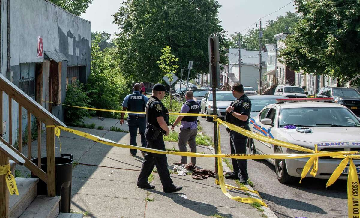 Albany Police members search for the murder weapon in the area near 297 Orange Street where a man was allegedly stabbed to death early Thursday July 5, 2018 in Albany, N.Y. (Skip Dickstein/Times Union)
