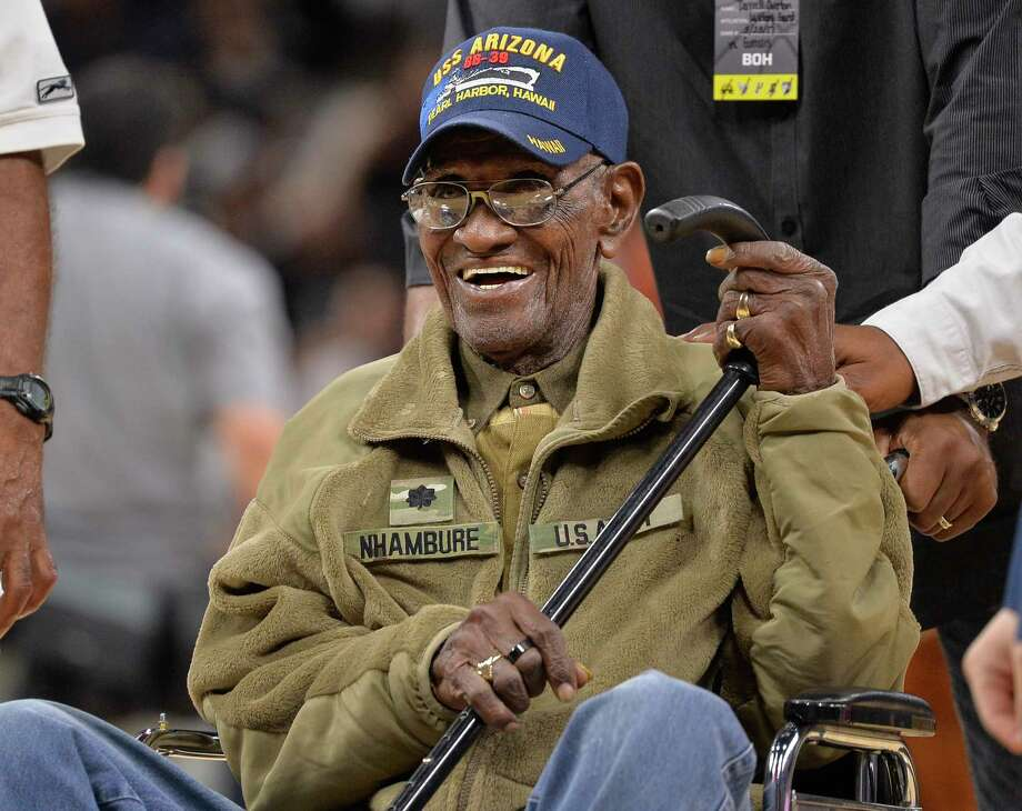 "FILE - In this March 23, 2017, file photo, Richard Overton leaves the court after a special presentation honoring him as the oldest living American war veteran, during a timeout in an NBA basketball game between the Memphis Grizzlies and the San Antonio Spurs.  The family of Richard Overton says Social Security and banking account numbers for the 112-year-old Austin man were used to make seven withdrawals over the past several months. Cousin Volma Overton declined to say how much was stolen but said it was a ""significant amount of money.""  He says the money was used to purchase savings bonds. A police report was filed Friday, June 30, 2018.   (AP Photo/Darren Abate, File) Photo: Darren Abate / FR115 AP"