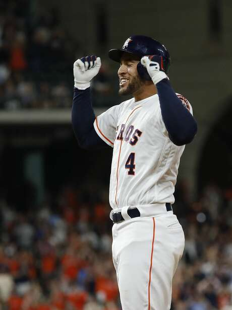 Houston Astros George Springer (4) reacts after hitting his RBI single to tie the game during the ninth inning of an MLB game at Minute Maid Park, Thursday, July 5, 2018, in Houston. ( Karen Warren  / Houston Chronicle ) Photo: Karen Warren/Houston Chronicle
