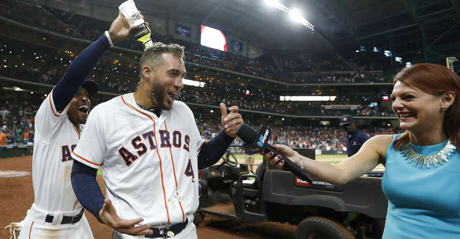 Houston Astros George Springer (4) is doused with Powerade by Tony Kemp (18) as he was interviewed by Julia Morales after his RBI single tied the game of an MLB game at Minute Maid Park, Thursday, July 5, 2018, in Houston. ( Karen Warren  / Houston Chronicle ) Photo: Karen Warren/Houston Chronicle
