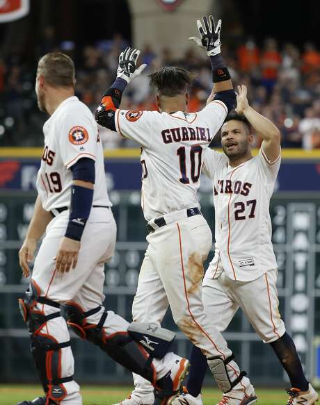 Houston Astros Yuli Gurriel (10) celebrates with Jose Altuve (27) after hitting his walk off single to score the winning run during the ninth inning of an MLB game at Minute Maid Park, Thursday, July 5, 2018, in Houston. ( Karen Warren  / Houston Chronicle ) Photo: Karen Warren/Houston Chronicle