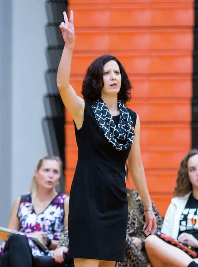 Edwardsville's Jami Parker, shown asking for a double-contact call in a home match against Belleville West last season, is the 2017 Large-Schools Volleyball Coach of the Year. Photo:       Scott Kane / For The Telegraph