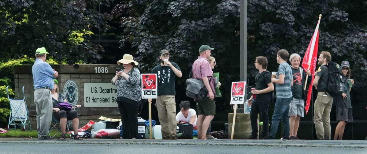 ICE-Free Capital District and coalition partners demonstrated at the USCIS office Friday July 6, 2018 in Latham, N.Y. (Skip Dickstein/Times Union)