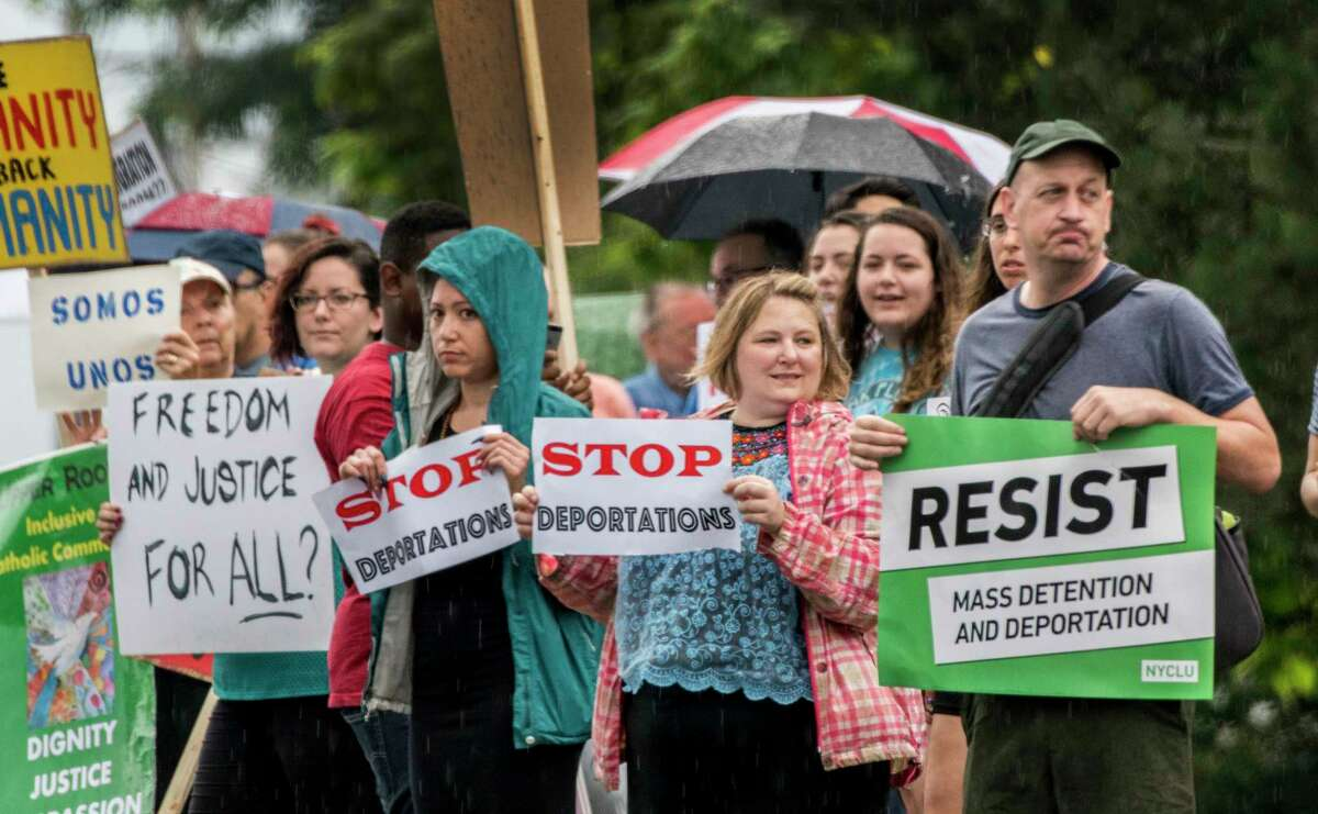 ICE-Free Capital District and coalition partners demonstrated at the USCIS office Friday July 6, 2018 in Latham, N.Y.(Skip Dickstein/Times Union)