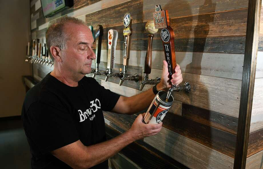 Gary Marler fills a crowler of craft beer for delivery to a customer at Brew 30 Taphouse in Cypress on July 5, 2018. (Jerry Baker/For the Chronicle) Photo: Jerry Baker, Freelance / For The Chronicle / Freelance