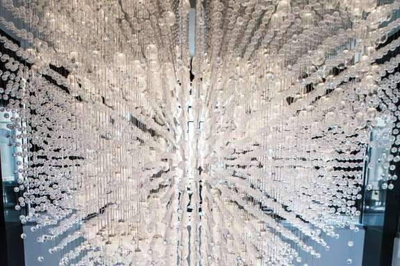 An spectacular chandelier lights the lobby of The Post Oak Hotel, Wednesday, March 14, 2018, in Houston. ( Marie D. De Jesus / Houston Chronicle )