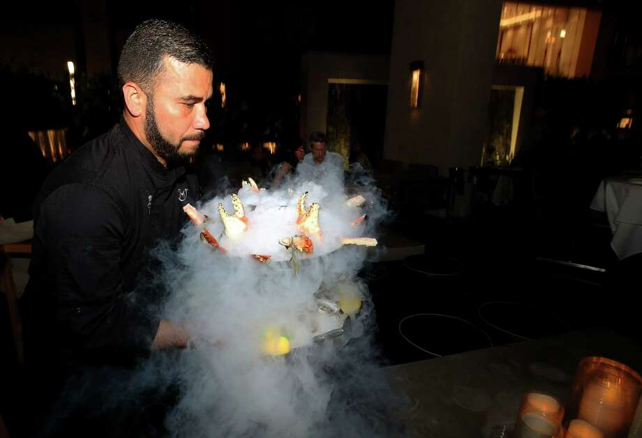 The seafood tower, a staple item at Mastro's steakhouse, gets the dry-ice treatment.