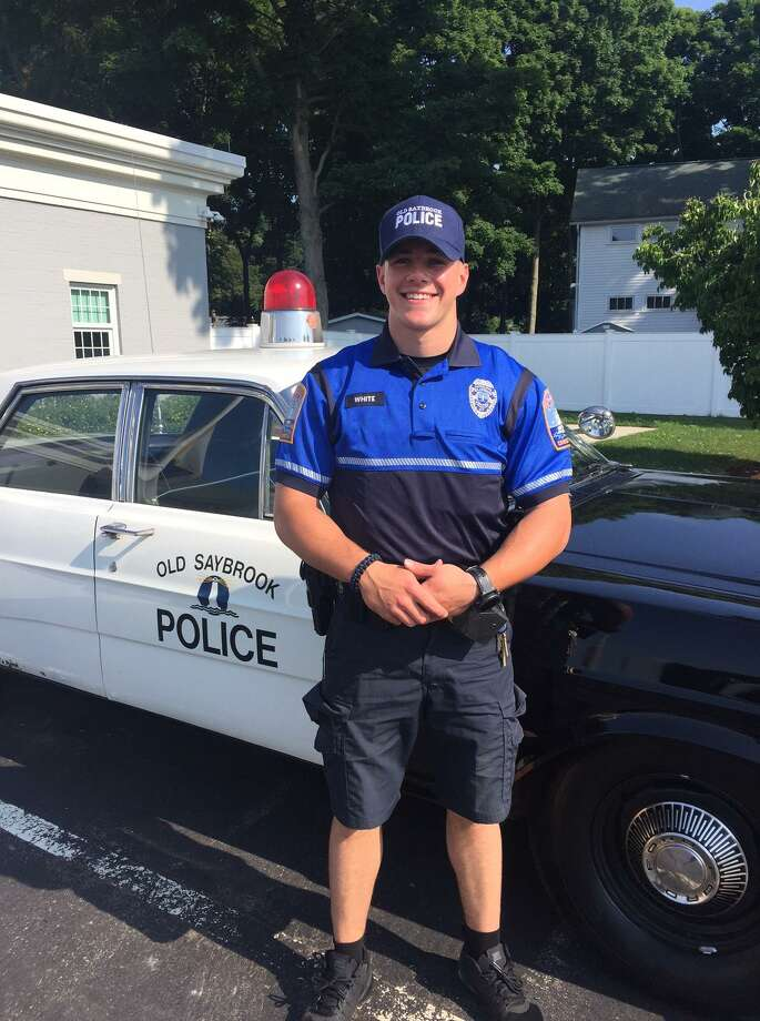 Old Saybrook police officers are sporting a new summer uniform to help raise money for Sean MacDonnell, a 4-year-old with a rare type of cancer. Photo: By Newsroom Staff / Photo Courtesy Of Old Saybrook Police
