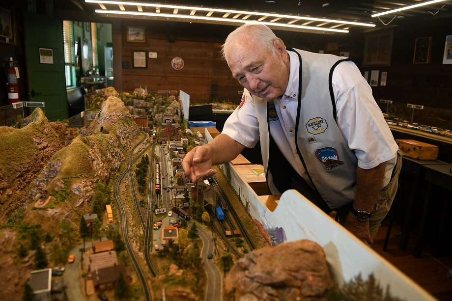 "David ""Mister Dave"" George' of Spring, shows off one of the train cars from his Z- scale Golden-Blackhawk & Central City Railroad model on display inside the 1907 Depot Museum in Tomball on July 3, 2018. (Jerry Baker/For the Chronicle) Photo: Jerry Baker, Freelance / For The Chronicle / Freelance"