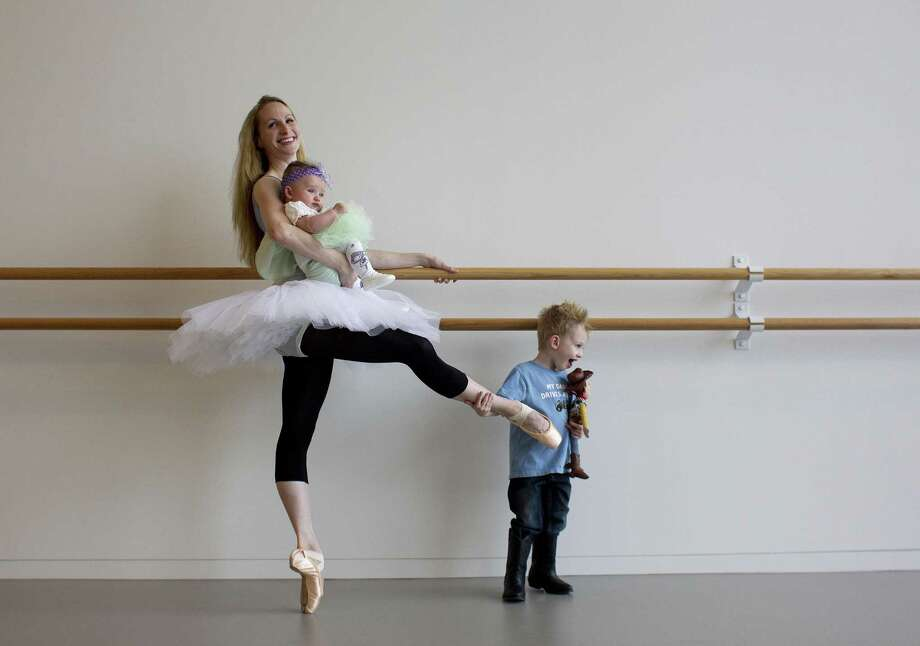 Webb in Houston Ballet's studios in 2011, with son Joshua, who was then 3, and daughter Lillian, who was then four months old. Photo: Johnny Hanson, Staff / Houston Chronicle / Houston Chronicle