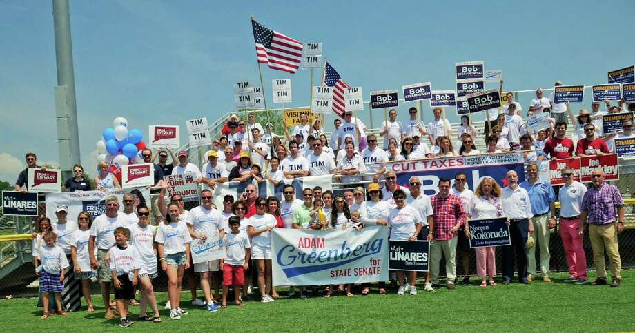 Republicans, including gubernatorial candidates Tim Herbst, Bob Stefanowski and David Stemerman and lieutenant governor candidates Joe Markley and Erin Stewart, gathered at the Madison 4th of July parade Wednesday, dropping their campaign spats for a group photo. Photo: Contributed
