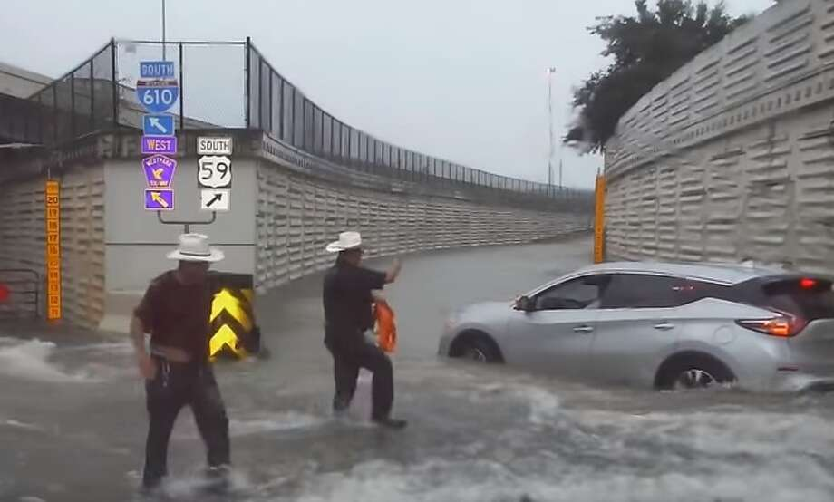 Deputies with the Harris County Precinct 5 Constable's Office were caught on dash cam video conducting a high-water rescue during Houston's July 4 downpour. Photo: Harris County Constable Precinct 5